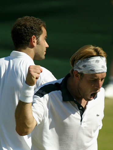 George Bastl of Switzerland celebrates after his victory over Pete Sampras of the USA in 2002