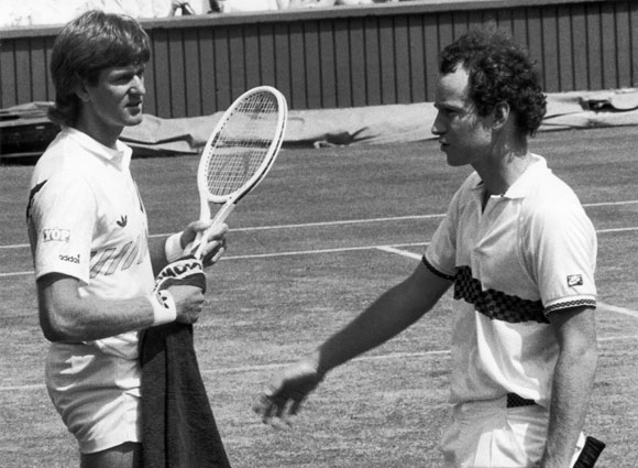 American tennis star John McEnroe about to shake the hand of South African player Kevin Curren after losing in 1985