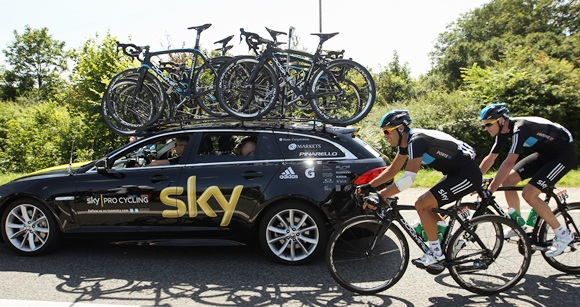 Richie Porte of Australia and SKY Procycling rides alongside the team car