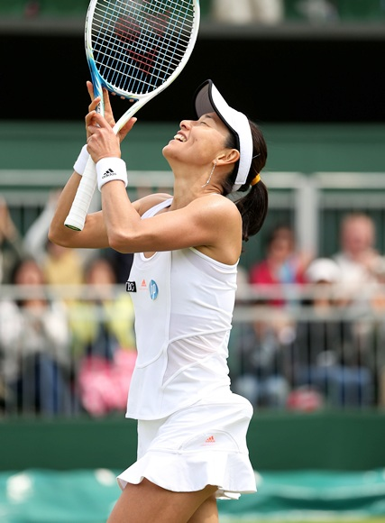 Kimiko Date-Krumm of Japan celebrates