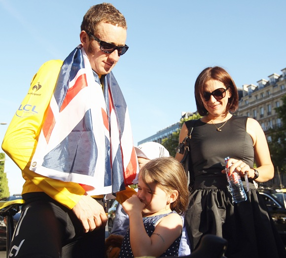 Bradley Wiggins of Great Britain and SKY Procycling celebrates with his wife Cath and children