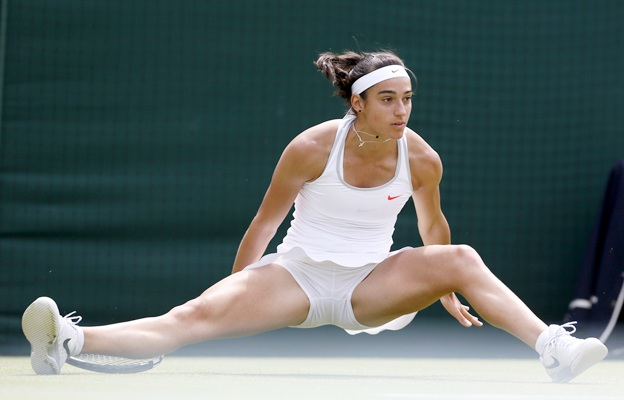 Caroline Garcia of France slips during her women's singles match against Serena Williams