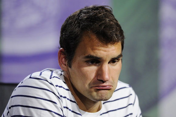 Roger Federer of Switzerland speaks to members of the media during a press conference
