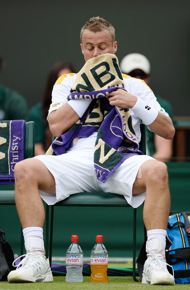 Lleyton Hewitt of Australia reacts during a break in his Gentlemen's Singles second round match against Dustin Brown