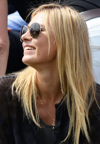 Maria Sharapova of Russia smiles during the Gentlemen's Singles second round match between Grigor Dimitrov of Bulgaria and Grega Zemlja of Slovenia