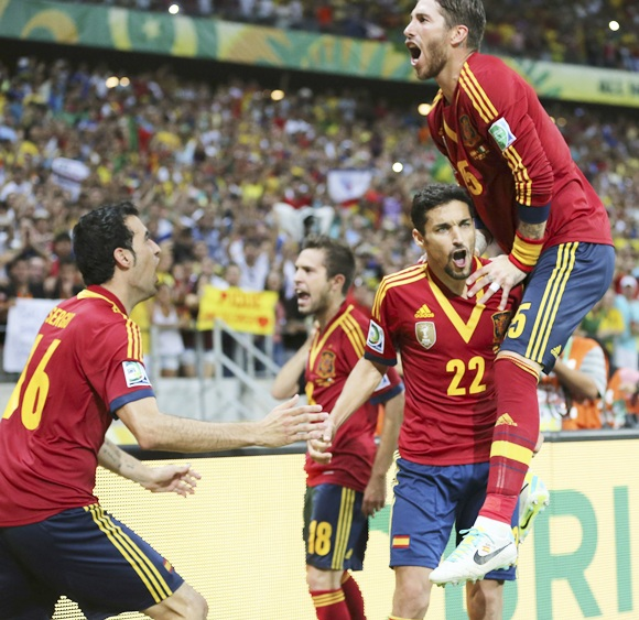 Spain's Jesus Navas (22) celebrates with his teammate