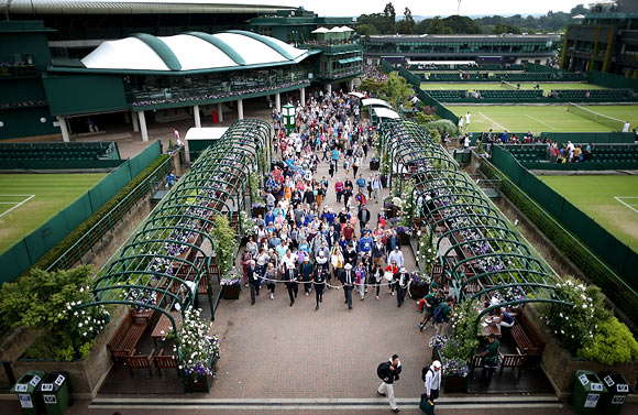 Spectators are admitted to the Wimbledon Lawn Tennis Championships