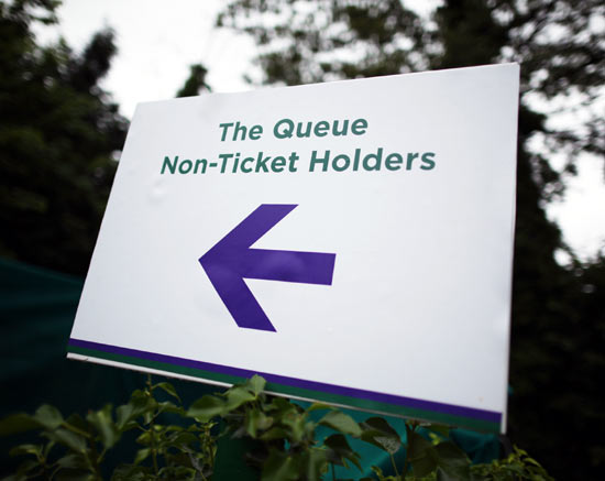 A sign points the way for non-ticket holders outside Wimbledon