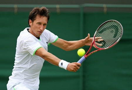 Sergiy Stakhovsky of Ukraine hits a backhand