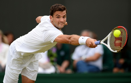 Grigor Dimitrov of Bulgaria stretches to play a backhand