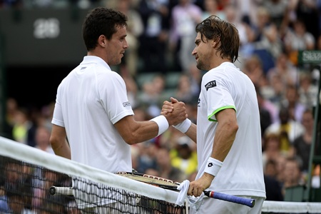 David Ferrer (R) shakes hands with defeated countryman Roberto Bautista