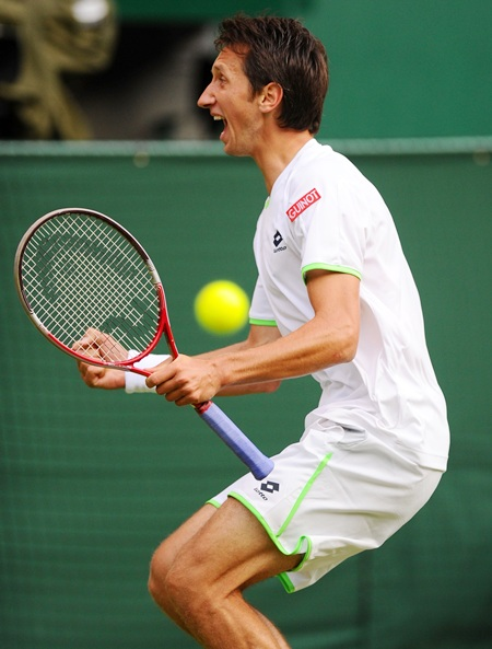 Sergiy Stakhovsky of Ukraine celebrates after beating Roger Federer