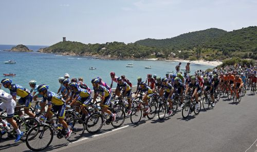 he pack of riders cycles along the coast as it makes its way during the 213 km first stage of the centenary Tour de France cycling race from Porto-Vecchio to Bastia