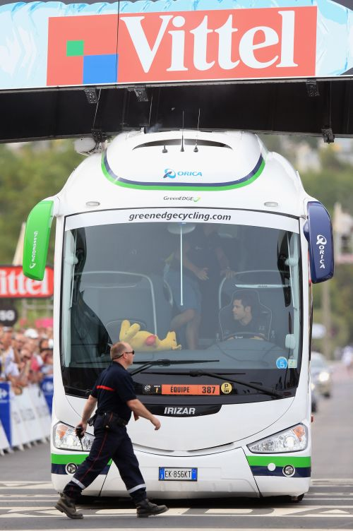 The Orica-Greenedge team bus collides with the finishing banner prior to the race arriving at the end of stage one of the 2013 Tour de France