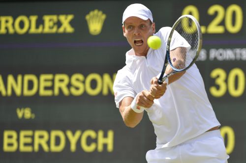 Tomas Berdych of the Czech Republic hits a return to Kevin Anderson of South Africa during their men's singles tennis match at the Wimbledon Tennis Championships