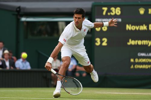 Novak Djokovic of Serbia plays a backhand during the Gentlemen's Singles third round match against Jeremy Chardy of France