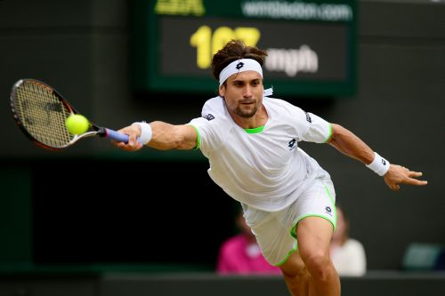 David Ferrer of Spain plays a forehand during the Gentlemen's Singles third round match against Alexandr Dolgopolov of Ukraine on day six of the Wimbledon Lawn Tennis Championships