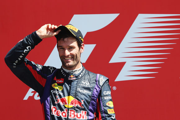Mark Webber of Australia and Infiniti Red Bull Racing celebrates on the podium after finishing second