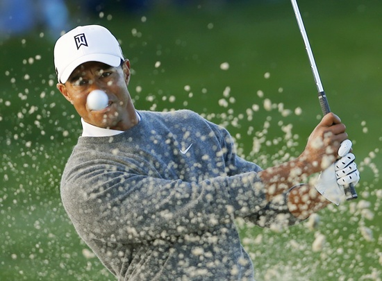 US golfer Tiger Woods hits from a sand trap