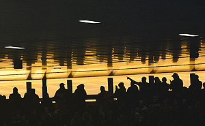 Arsenal fans watch a match at the Emirates stadium