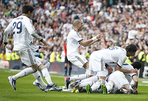 Real Madrid players celebrate after Sergio Ramos scored the winner against Barcelona at the Santiago Bernabeu stadium on Saturday