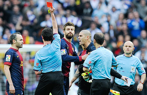 Victor Valdes of FC Barcelona is shown a red card by referee Perez Lasa during their 'Clasico' against Real Madrid on Saturday