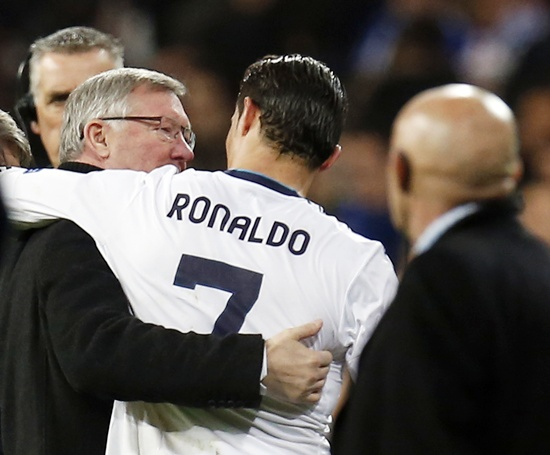 Manchester United's manager Sir Alex Ferguson (left) speaks to Real Madrid's Cristiano Ronaldo