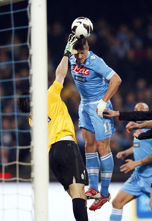 Juventus' goalkeeper Gianluigi Buffon (left) makes a save against Napoli's Christian Maggio
