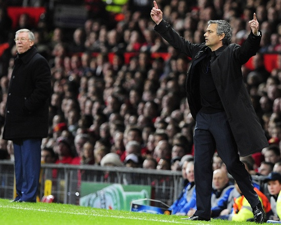 Real Madrid coach Jose Mourinho (right) gestures as Manchester United manager Alex Ferguson watches