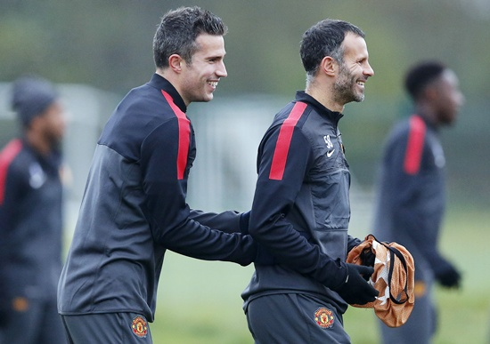Manchester United's Robin van Persie (left) laughs with Ryan Giggs