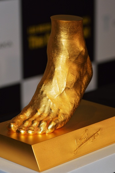 A golden statue of the left foot of Lionel Messi is displayed at the launching at Harajuku Quest Hall  in Tokyo, Japan.