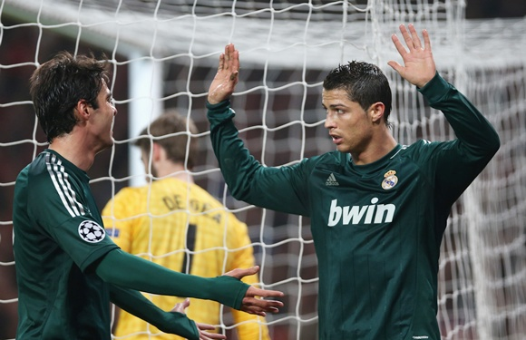 Cristiano Ronaldo of Real Madrid (right) reacts after scoring
