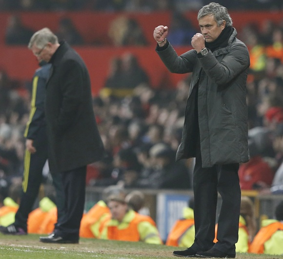 Real Madrid's coach Jose Mourinho reacts near Manchester United manager Alex Ferguson (left)