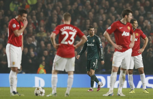 Real Madrid's Cristiano Ronaldo (centre) reacts after scoring against Manchester United