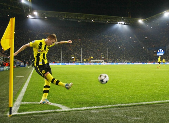 Borussia Dortmund's Marco Reus takes a corner kick