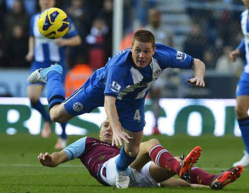 West Ham United's Mark Noble (R) challenges Wigan Athletic's James McCarthy