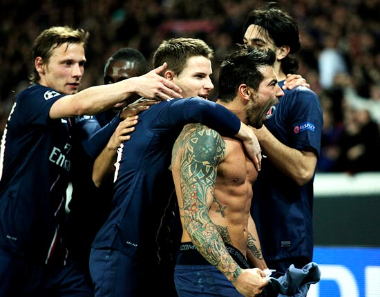 PSG's Ezequiel Lavezzi (right) celebrates with team mates after scoring the goal