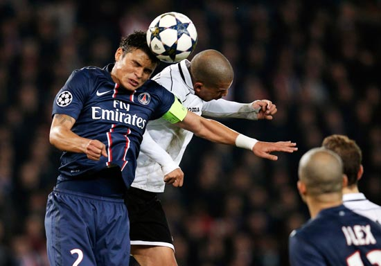 Thiago Silva of PSG (left) and Sofiane Feghouli of Valencia battle for the header