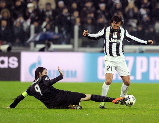 Andrea Pirlo of Juventus duels for the ball with Celtic's Giorgios Samaras