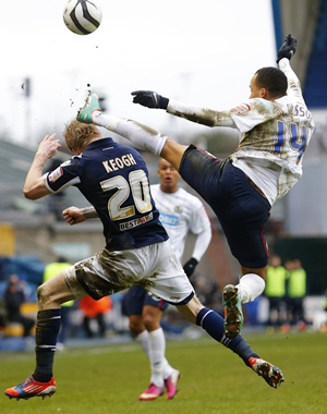 Andy Keogh (left) of Millwall and Markus Olsson of Blackburn Rovers
