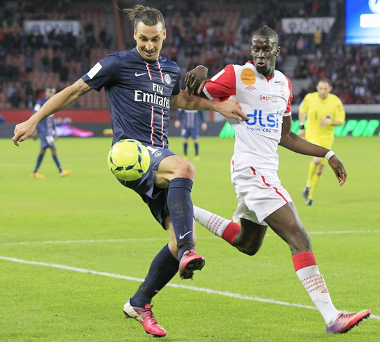 Paris Saint-Germain's Zlatan Ibrahimovic challenges Nancy's Salif Sane