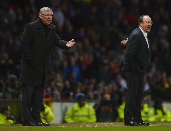 Manchester United's manager Alex Ferguson (left) gestures as Chelsea's interim manager Rafael Benitez shouts