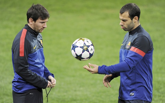 Barcelona's Lionel Messi (left) and Javier Mascherano
