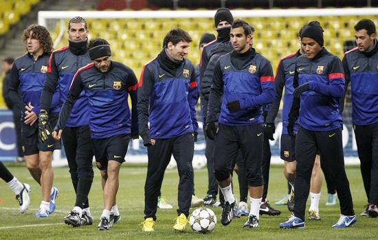 Barcelona players take part in a training session