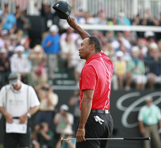 Tiger Woods reacts after his final putt