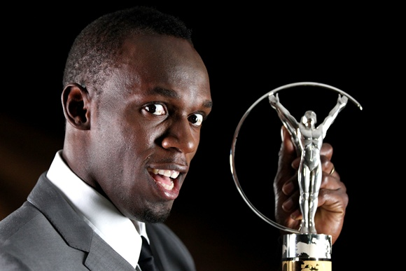 Usain Bolt with the Laureus World Sportsman of the Year award in 2013