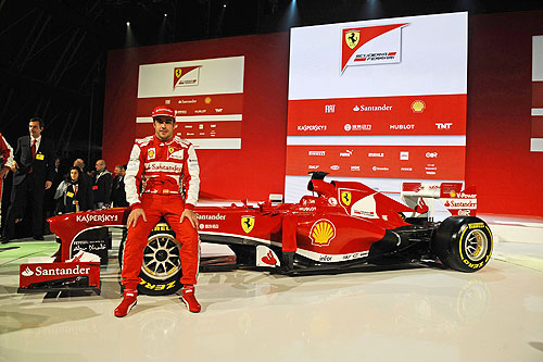 Ferrari Formula One driver Fernando Alonso of Spain poses near the new Ferrari F138 Formula One car