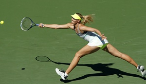 Maria Sharapova of Russia lunges for the ball