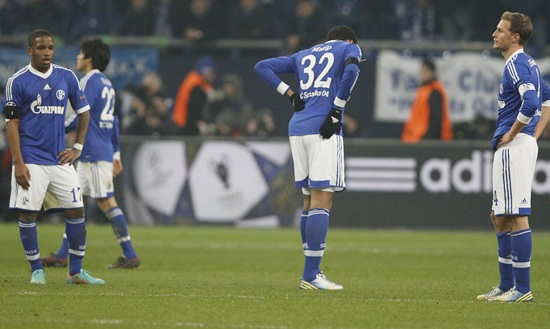 Schalke 04 players react following their defeat against Galatasaray
