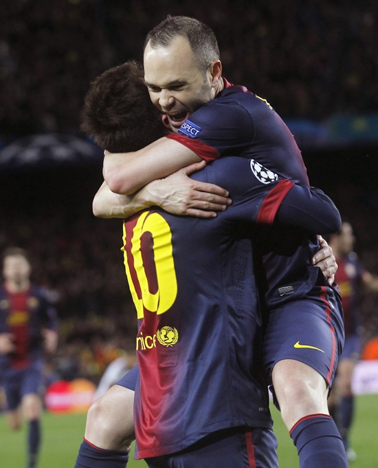 Barcelona's Lionel Messi celebrates with Andres Iniesta (right)